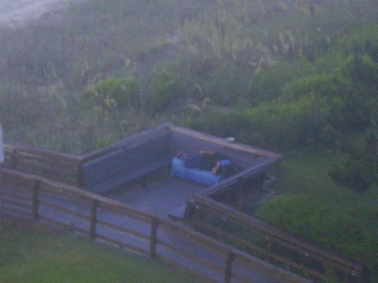 Homeless Man Sleeping on Beach Access Bench